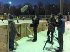 documentary crew working during blind hockey game